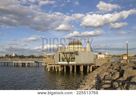 St Kilda, Australia: March, 2017: St Kilda Pier With The Iconic Little Blue Pavilion. The Breakwater