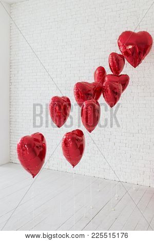 Lots Of Red Balloons In The Shape Of Heart. Multiple Red, Helium-filled, Heart-shaped Balloons Float