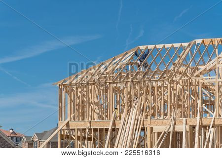 Close-up Two-story Stick Built Home With Building Contractor Carpenter In Texas, Usa