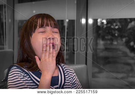 Stressed Asian Girl Yawn With Boredom As She Waits