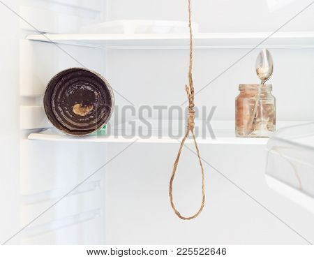 The Refrigerator Is Empty. Dirty Shelves. A Spoon In The Jar With The Remains Of Food On It Is Not W