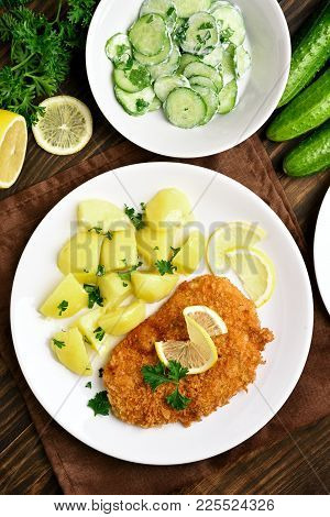 Dish For Dinner. Schnitzel With Boiled Potato And Cucumber Salad On Wooden Background. Top View, Fla
