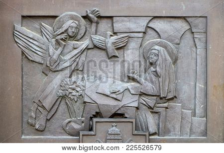 VARAZDIN, CROATIA - JULY 09: The Annunciation of Mary, detail of the entrance door of cathedral of Assumption in Varazdin, Croatia on July 09, 2016.