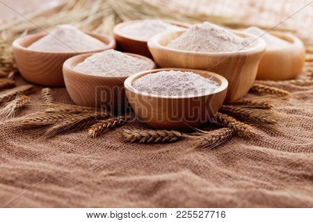 wooden bowls with different types of flour on jute - food and drink