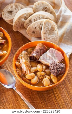 Bowl With Fabada Asturiana. Traditional Spanish Bean Stew With Chorizo, Bacon And Other Meats