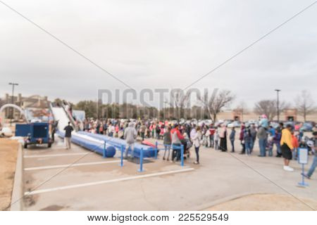 Blurred Giant Snow Tube Inflatable Slide At Community Event In Usa