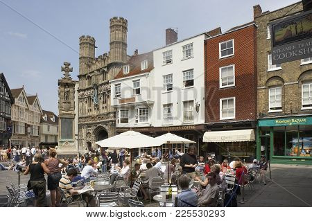 People Relaxing Eating And Drinking By Christ Church Gate Sun Street Canterbury Kent Englad