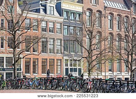 Amsterdam, Netherlands - April 3: A Lot Of Bcycles And Typical Architecture In City  On April 3, 201