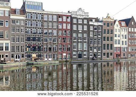 Amsterdam, Netherlands - April 3: Water Canal And Typical Architecture In City Amsterdam On April 3,