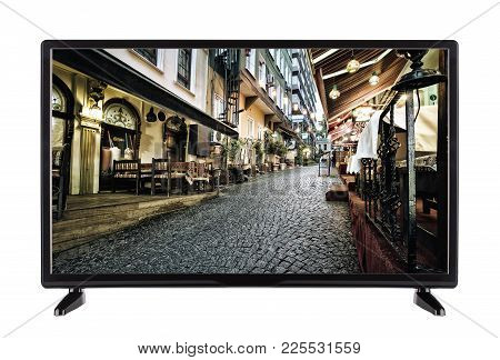 A High-definition Tv With Street Picture Of The City And  Stone Road