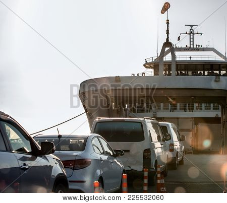 Loading Of Cars On The Ferry For Transportation To The Other Shore.
