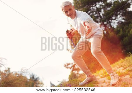Rely On Me. Full Length Of Elderly Man Holding A Crutch While Putting His Hand Forward And Suggestin