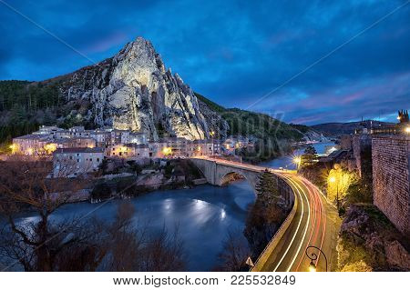 Sisteron In The Evening: The Rocher De La Baume - Peculiar Shaped Rock And Bridge Over Durance River