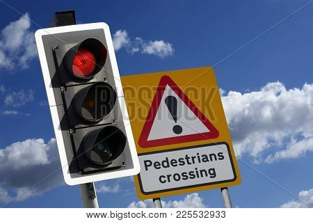 Road Traffic Light And Pedestrian Crossing With Blue Sky
