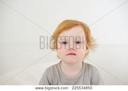 The little girl just woke up on the white background