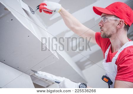 Residential Remodeling Drywall Patching. Caucasian Contractor In His 30s. Construction Theme.