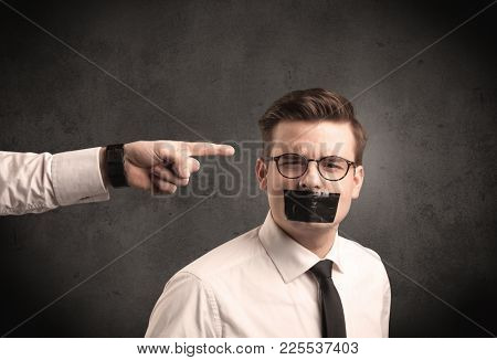 Caucasian business hand pointing at subordinate male employe