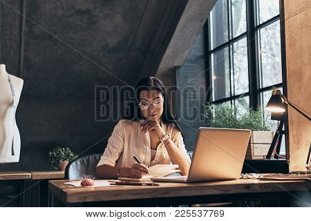And Then I Am Going To Meet With... Concentrated Young Woman Checking Out Her Notes In Personal Orga