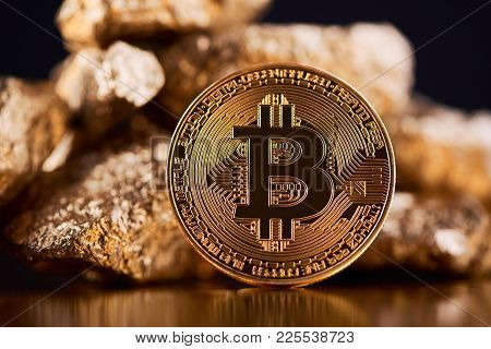 Encrypted Golden Bitcoin Lying In Front Of Blurred Gold Lumps Being Most Important Finance Trends No