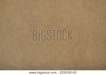 Fragment Of The Surface Of Fibrous Synthetic Non-woven Material Of Light Brown Color. Background, Te
