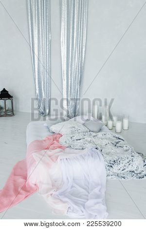Decorative Bed Canopy In Calm And Relaxing Bedroom With A Lot Of Candles