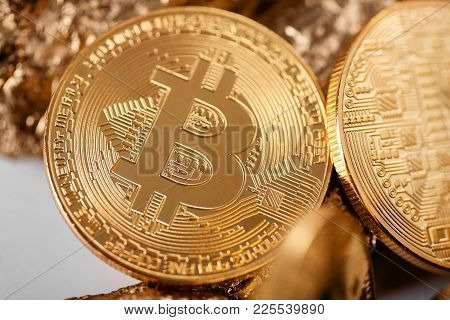 Closeup Of Golden Bitcoin As Main Cryptocurrency With Gold Lumps Being Blurred On Background. Blockc