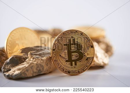 Shiny Golden Bitcoin Being Biggest Cryptocurrency Worldwide Next To Lumps Of Gold Isolated On White