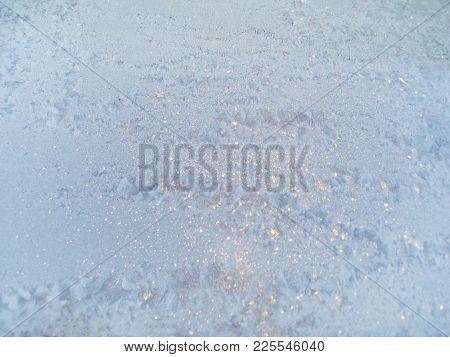 Winter Ice Frost Window Pattern Textured Background. Snowy Frosted Wintery Wallpaper Image With Icy