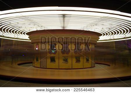 Carousal Merry Go Round Motion Blur Yellow Lights Amusement Fun, Long Exposure