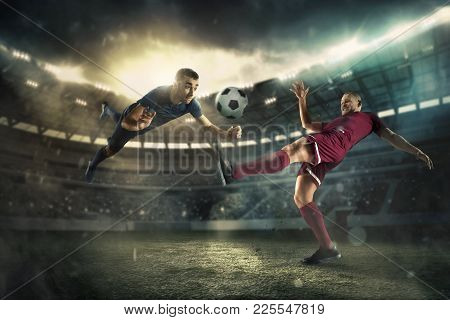 The Football Player In Motion On The Field Of Stadium With Lights. The Professional Football, Soccer