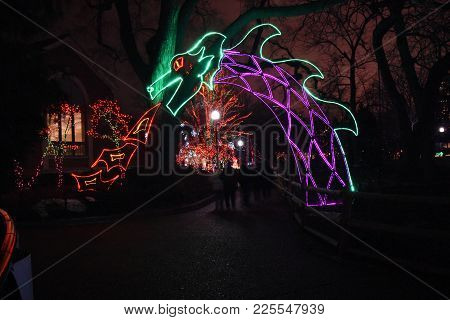 Green And Purple Dragon Breathing Red And Yellow Flames Light Display Illumination At Zoo Lights, Li