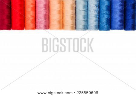Colored Bobbins On White Background. Colorful Cotton Yarns On Rolls For Sewing.