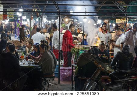 Marrakech, Morocco - January 2, 2018: People Preparing Food And Others Are Eating In Food Stalls At