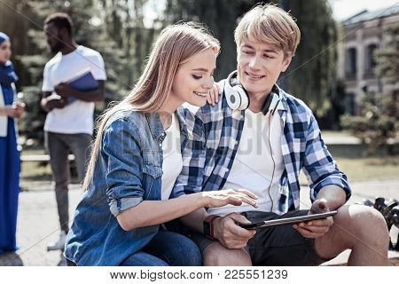 Young Generation. Happy Delighted Young Woman Sitting Together With Her Friend And Holing His Should