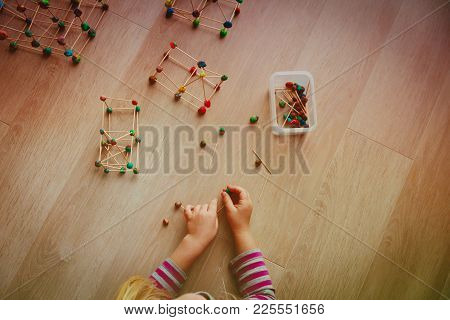 Little Girl Making Geometric Shapes, Engineering And Stem Education Concept