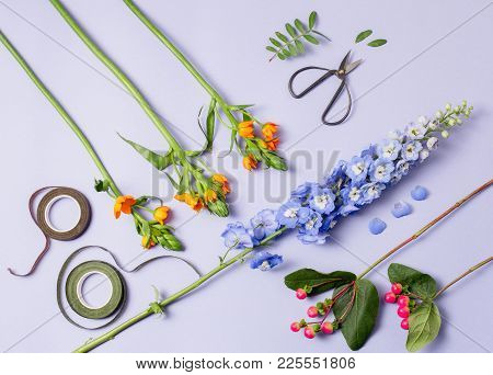 Tools And Accessories Florists Need For Making Up A Bouquet. The White Wooden Florist Workplace. Top