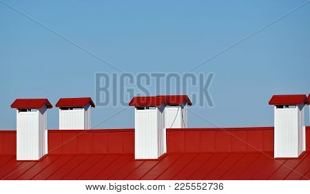 The Smokestacks On Background Of Blue Sky