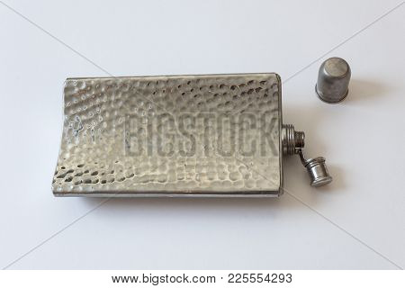 Curved Metal Flask Lying On Its Side, Cap Off And Top Open, Drinking Alcoholism Addiction Concept, I