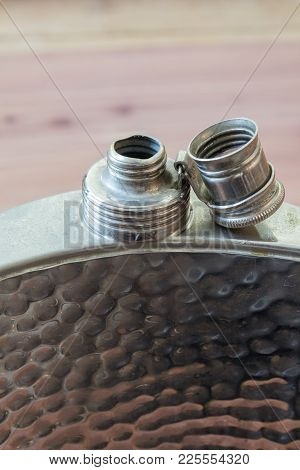 Front View Of Open Metal Flask, Drinking Alcoholism Addiction Concept, Background Soft, Copy Space,