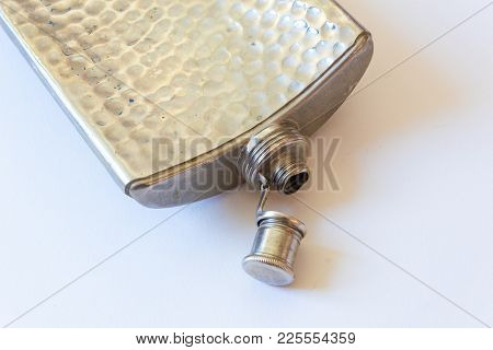 Open Metal Flask Isolated On White, Drinking Alcoholism Addiction Concept, Copy Space, Horizontal As