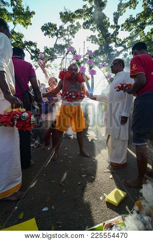 Kavadi With Help From Family Members During Thaipusam Festival..