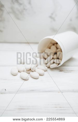 Animal Pet Care. Vitamins Pills For Pets In A Cup On White Board Background, Closeup. Pet Care And V