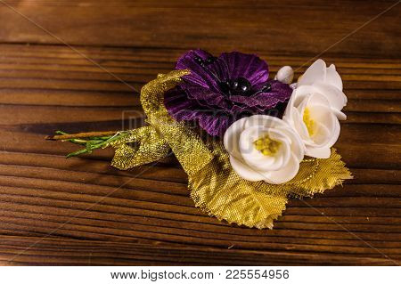 Beautiful Multicolored Brooch On Rustic Wooden Table