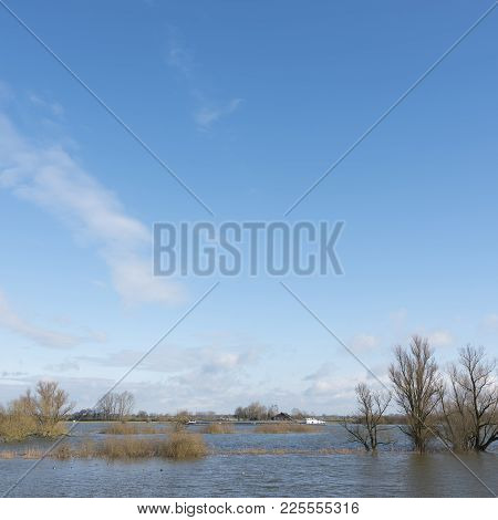 Flooded Flood Plains Of River Ijssel And Ship Near Zalk Between Kampen And Zwolle In The Netherlands