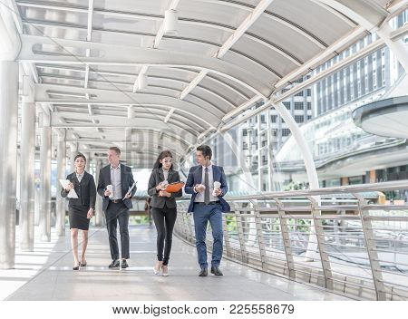 Happy Business Colleagues Walking Outside Office & Talking To Each Other. Businessman Walk Talk And