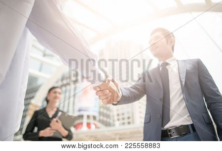 Handshake Of Business People Colleagues Teamwork Meeting .hold Hand And Shake Hand In City Building