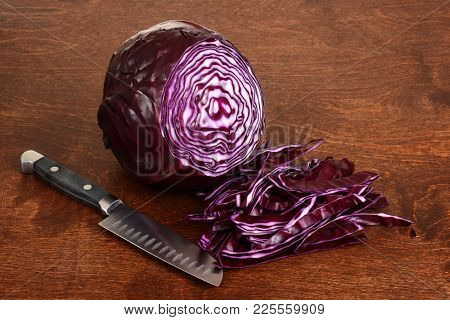 Sliced Red Cabbage With Knife On Wood Table