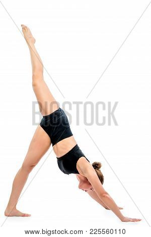 Stretching Exercises By A Young Woman On A White Background
