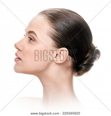 Attractive Young Woman In Profile With Healthy Fresh Skin. A Picture With White Vignetting