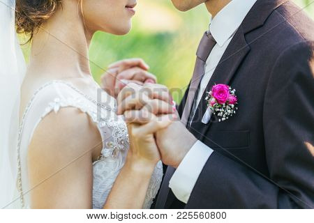 Newlyweds Are Holding Each Other's Hands